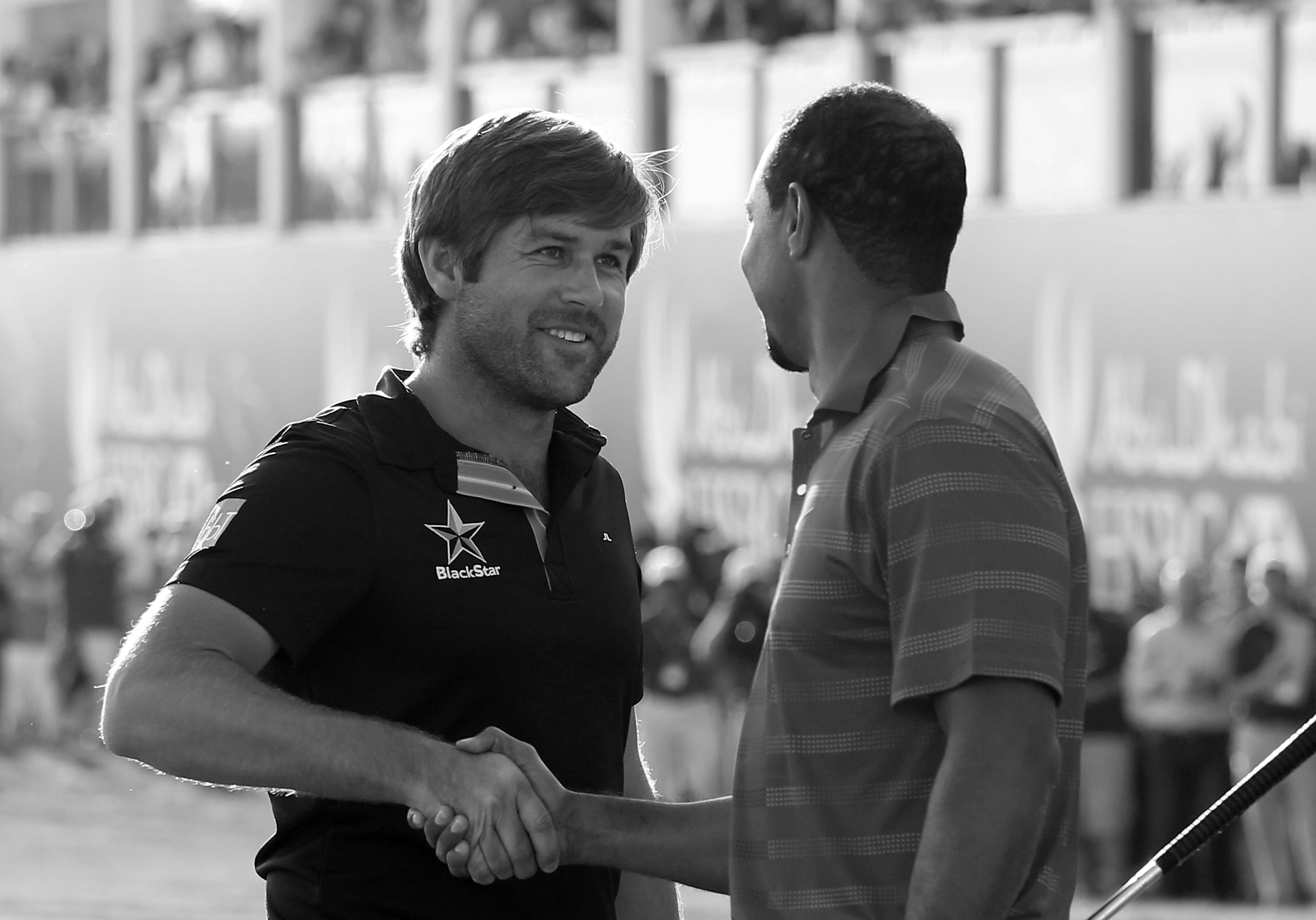 ABU DHABI, UNITED ARAB EMIRATES - JANUARY 29:  Robert Rock of England (L) is congratulated by Tiger Woods of the USA after winning The Abu Dhabi HSBC Golf Championship at Abu Dhabi Golf Club on January 29, 2012 in Abu Dhabi, United Arab Emirates.  (Photo by Andrew Redington/Getty Images)